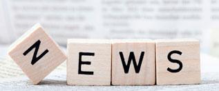 """Vier Würfel mit Buchstaben formen das Wort """"NEWS"""""""